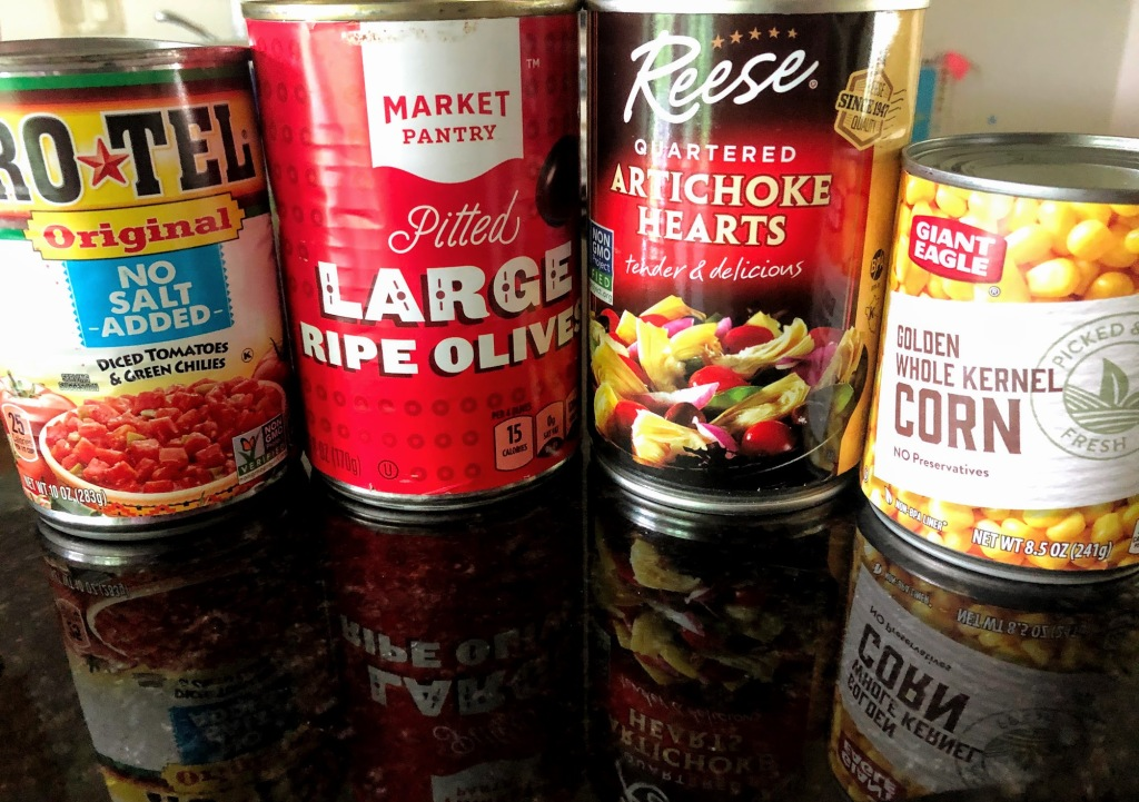 4 cans: diced tomatoes with green chiles, olives, artichoke hearts, and corn