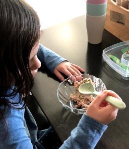 Kid eating tuna salad